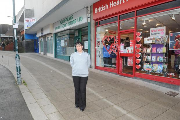 South Wales Argus: British Heart Foundation volunteer Miriam Masefield outside the shop in Upper Dock Street which is suffering from a lack of footfall due to the redevelopment of the area (3428666)