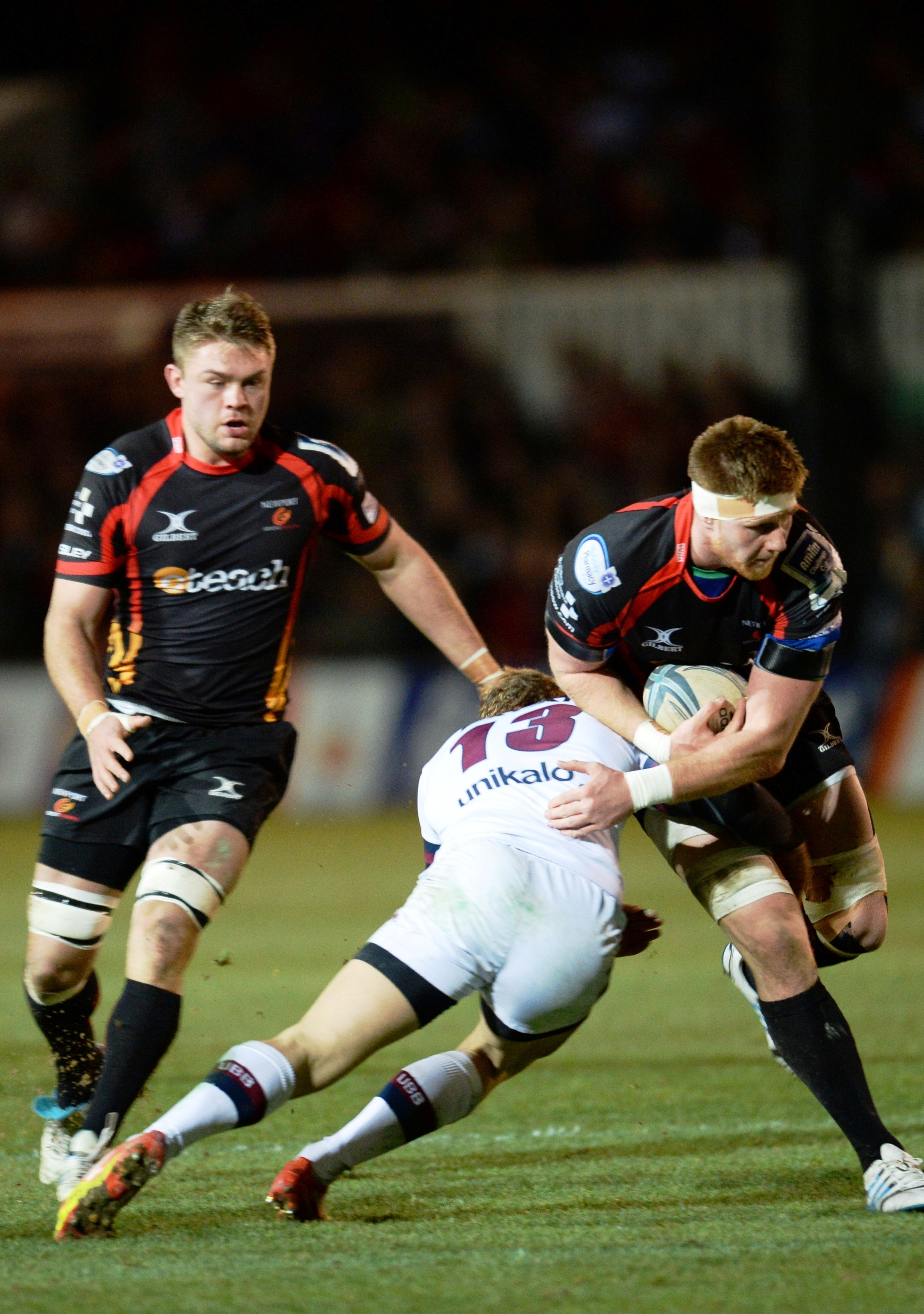 Newport Gwent Dragons v Union Bordeaux-Begles Amlin nChallenge CupDragons captain Andrew Coombs is held in the tackle as Lewis Evans looks on (2884213)