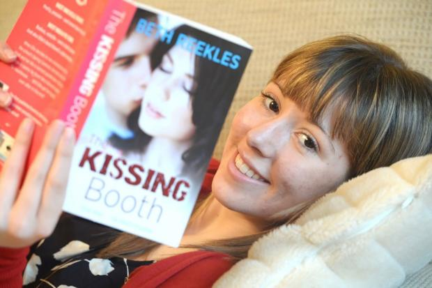 South Wales Argus: SUCCESS STORY: Beth Reekes with her novel The Kissing Booth
