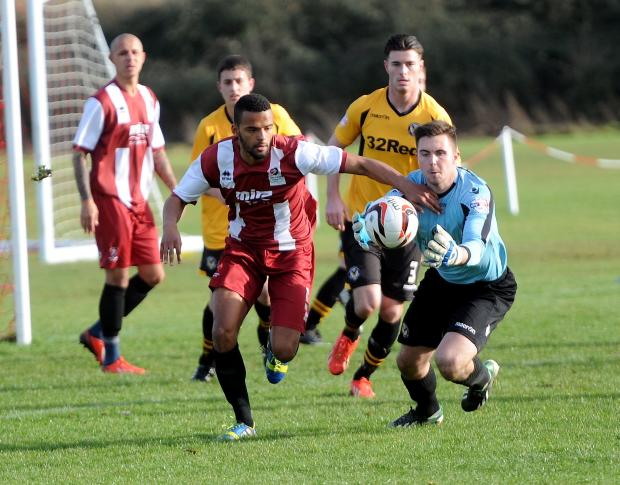 RETURN: Jamie Stephens in action against Cheltenham Town reserves on Tuesday. Picture: Paul Nicholls, Gloucestershire Echo