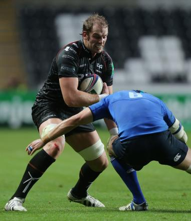 Ospreys captain Alun Wyn Jones trys to break past the the tackle of Leinster's Kevin McLaughlin during the Heineken Cup match at the Liberty Stadium, Swansea. PRESS ASSOCIATION Photo. Picture date: Saturday October 12, 2013. See PA story RUGBY Ospreys