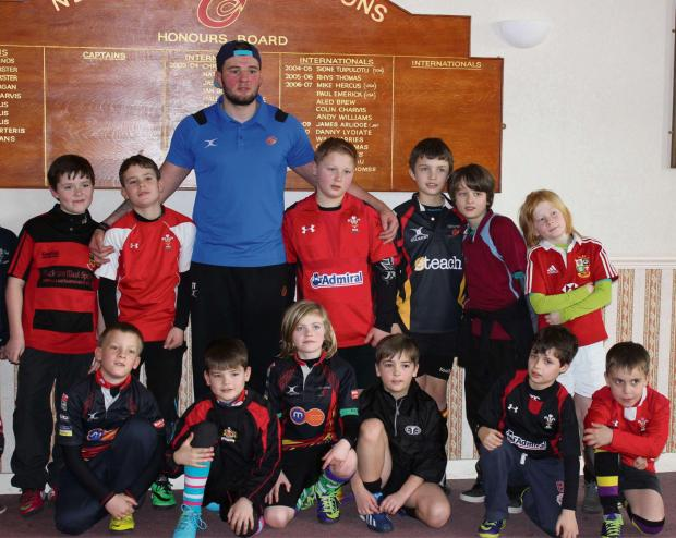 South Wales Argus: GREAT DAY: The New Inn pupils pose for a photograph with Dragon, Ieuan Jones.