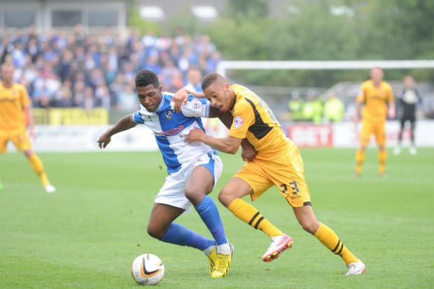 SEVERNSIDE DERBY: Christian Jolley tackles Ellis Harrison in our win over Bristol Rovers in August