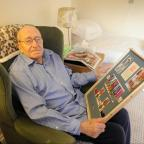 South Wales Argus: War veteran Cliff Davies will be turning 90 on February 4th.  He was recently presented by the crew of HMS Severn his war time medals in a framed mount.  Pictured is Cliff with his framed mount containing his medals, pictures and insignias. (3639023)