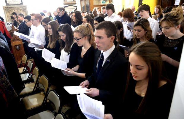 MEMORIAL: Pupils of various schools join in the service at St Cadoc's Church in Trevethin