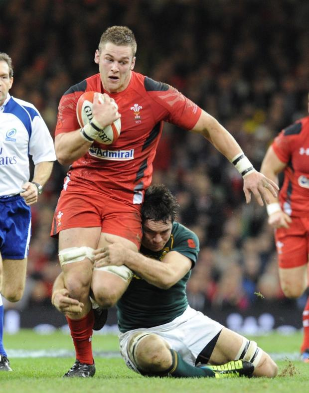 South Wales Argus: Dan Lydiate is tackled by Francois Louw (2397193)
