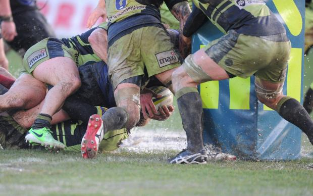 South Wales Argus: Newport Gwent Dragons v Northampton Saints in LV Cup. Dragons so close to scoring a try late in the second half in the wet pitch conditions. (3639450)