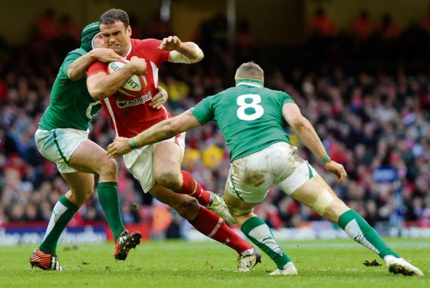 South Wales Argus: RETURN: Jamie Roberts in action for Wales against Ireland in the 2013 Six Nations