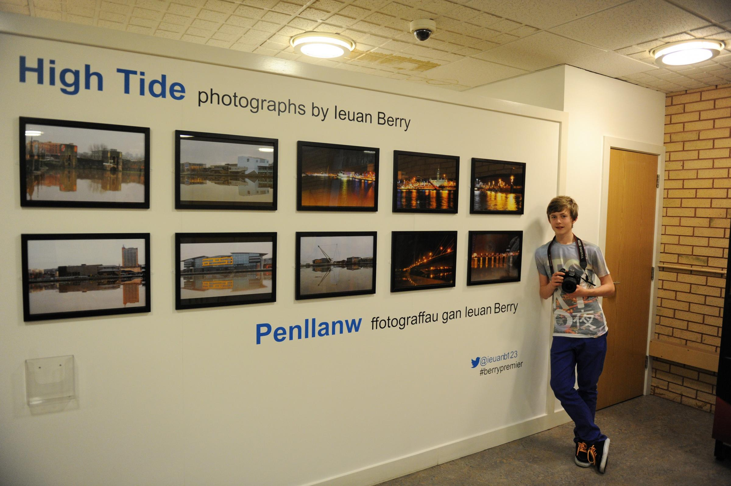 At the central library local teenager and passionate amateur photographer Ieuan Berry is displaying some of work in an exhibition of the recent high tides and floods that hit Newport.  Pictured is Ieuan with his work on display. (3737211)