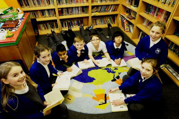 South Wales Argus: BOOKWORMS: Year five pupils in the library at High Cross Primary School in Rogerstone, Newport