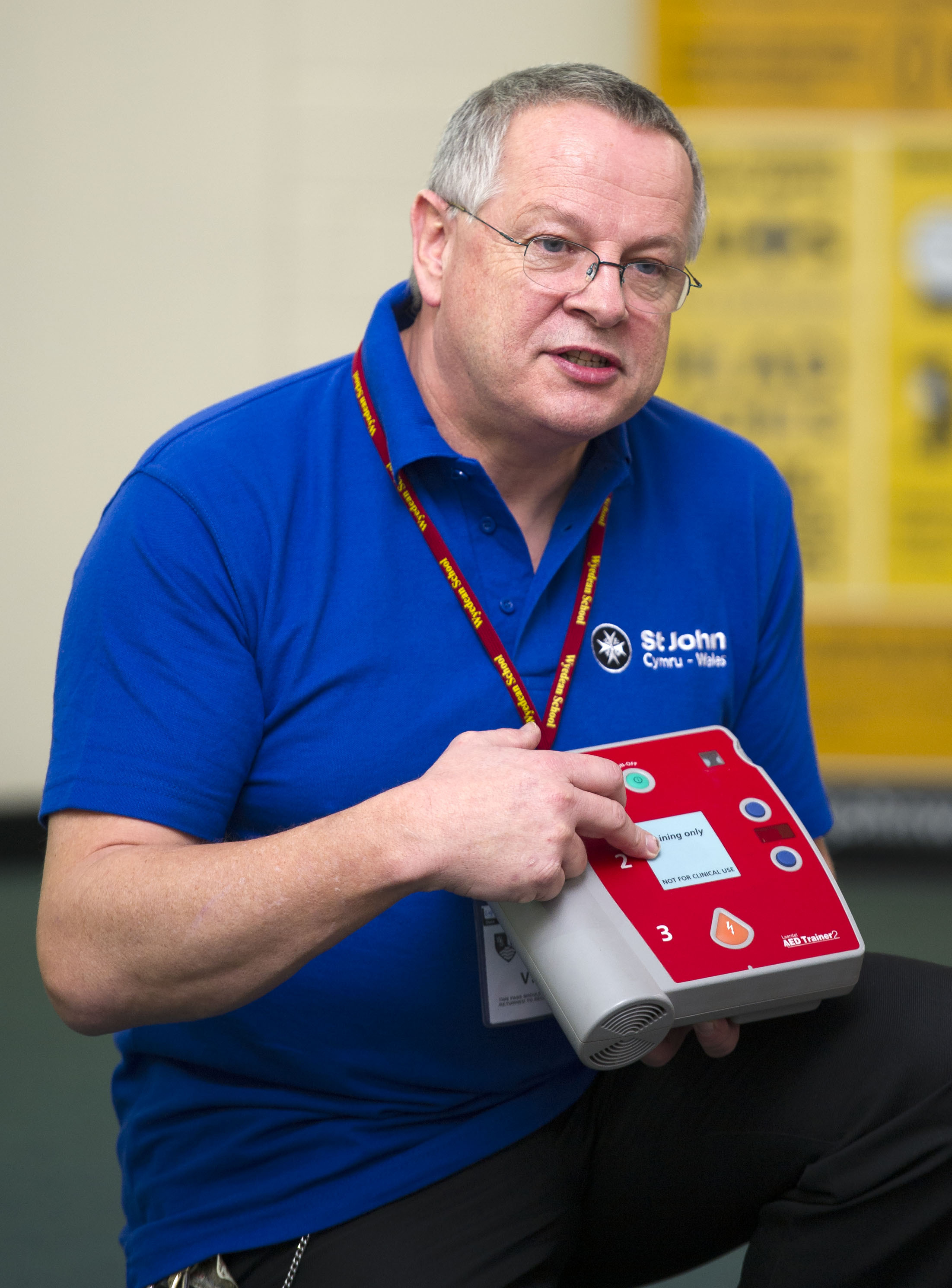 (3752709) Defibrillator training: St John Wales trainer David Ball explaining the workings of a defibrillator machine to pupils at Wyedean School, Chepstow.