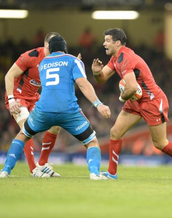 GOOD WIN: Mike Phillips takes on Marco Bartolami during Wales' 23-15 victory over Italy