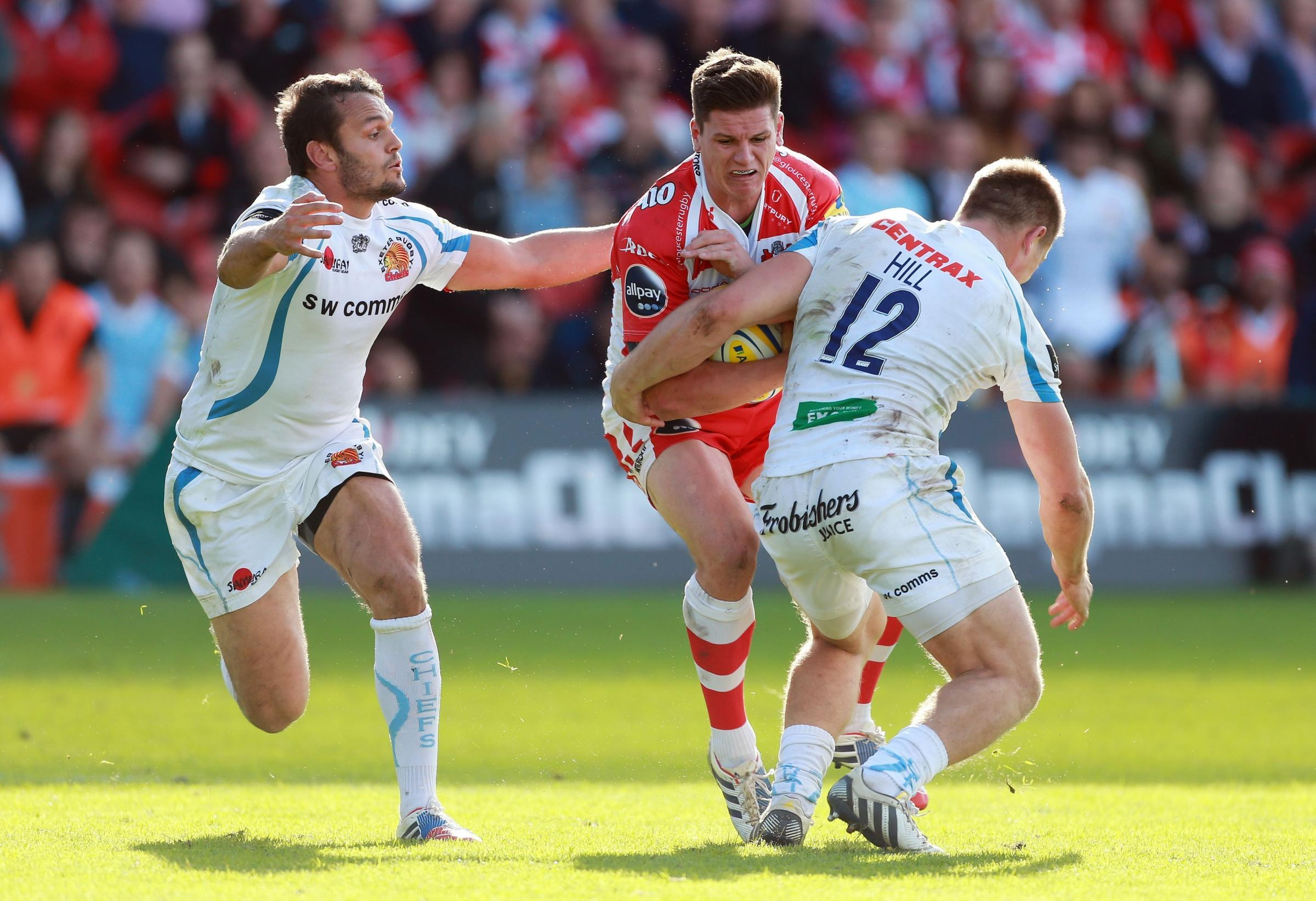 Gloucester's Freddie Burns is tackled by Exeter's Sam Hill and Phil Dollman during the Aviva Premiership match at Kingsholm Stadium, Gloucester. PRESS ASSOCIATION Photo. Picture date: Sunday October 6, 2013. Photo credit should read: David Davies/