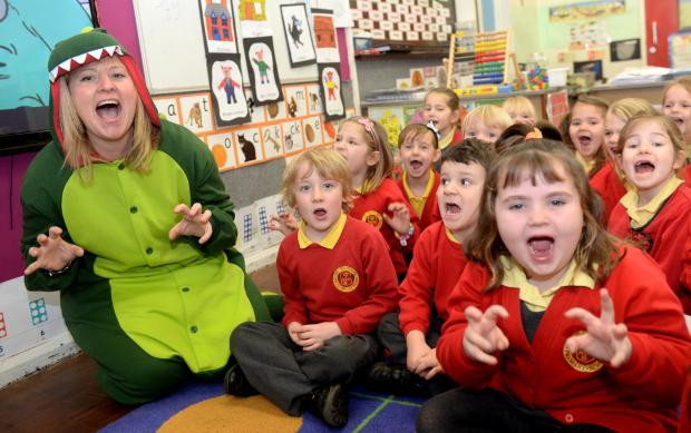 South Wales Argus: School of the Week - St David's RC Junior and Infants School - Cwmbran. Teacher Mrs Lewis teaching her Year One class about dinosaurs. (3450083)