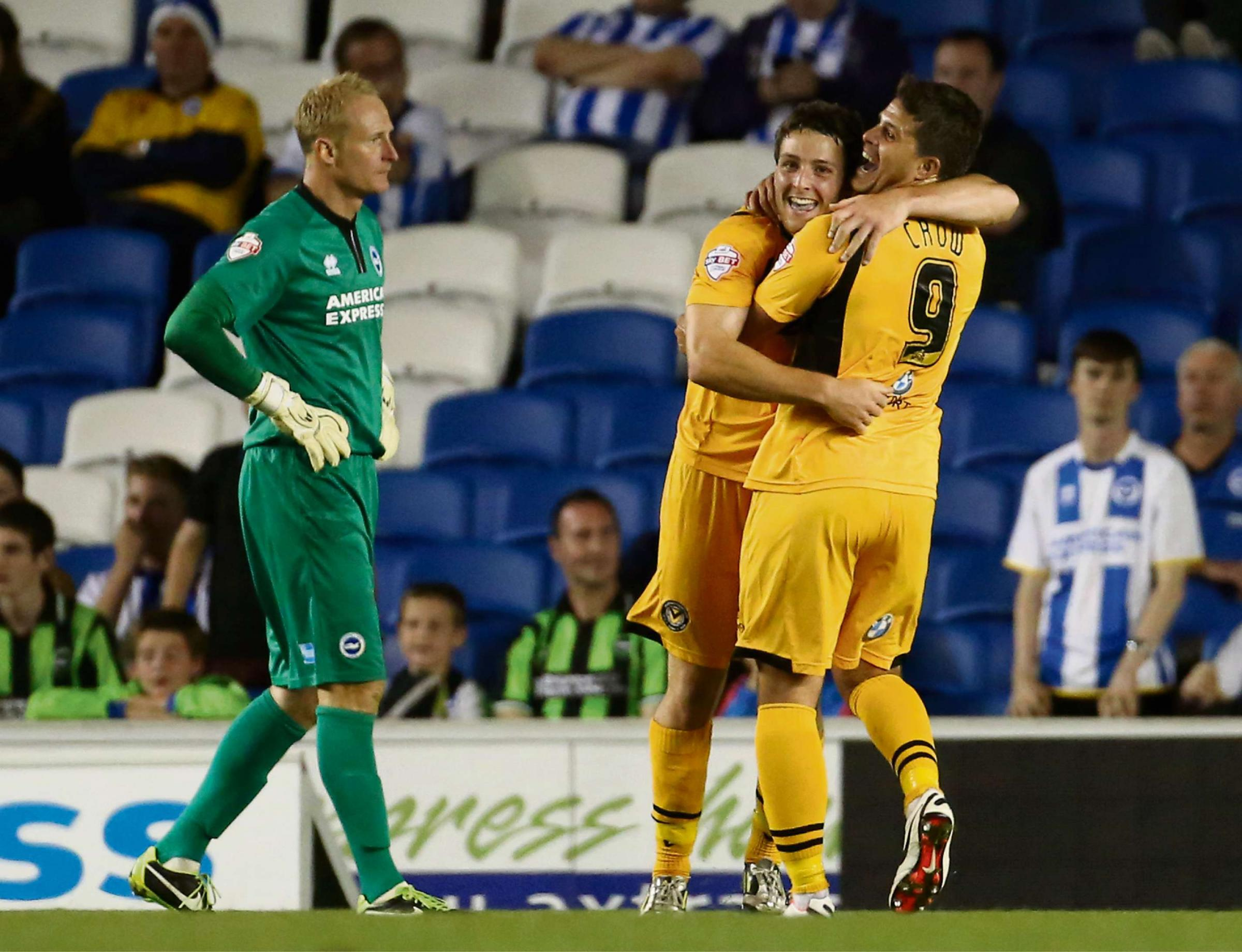 CUP SHOCK: Scorers Conor Washington, left, and Danny Crow celebrate at Brighton in the Capital One Cup last August