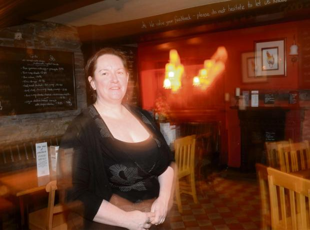 SPOOKY CLAIM: Landlady Karen Reed inside the Hen and Chickens