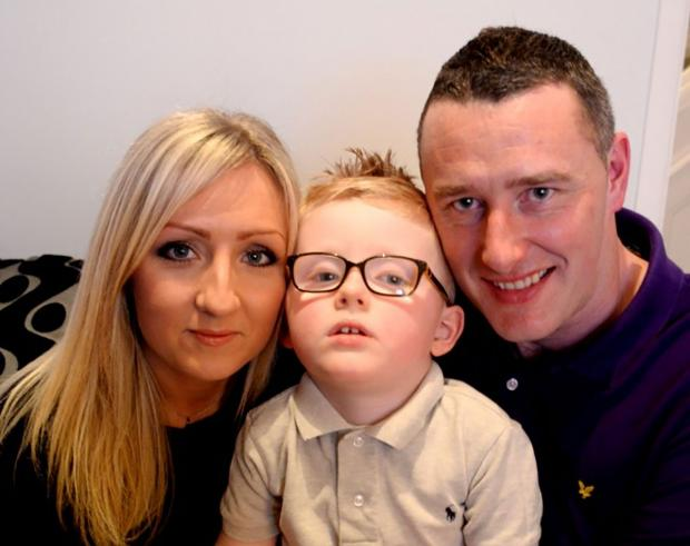 BURGLED: Leo Dixon at home in Newport with mum Kate and dad Mike