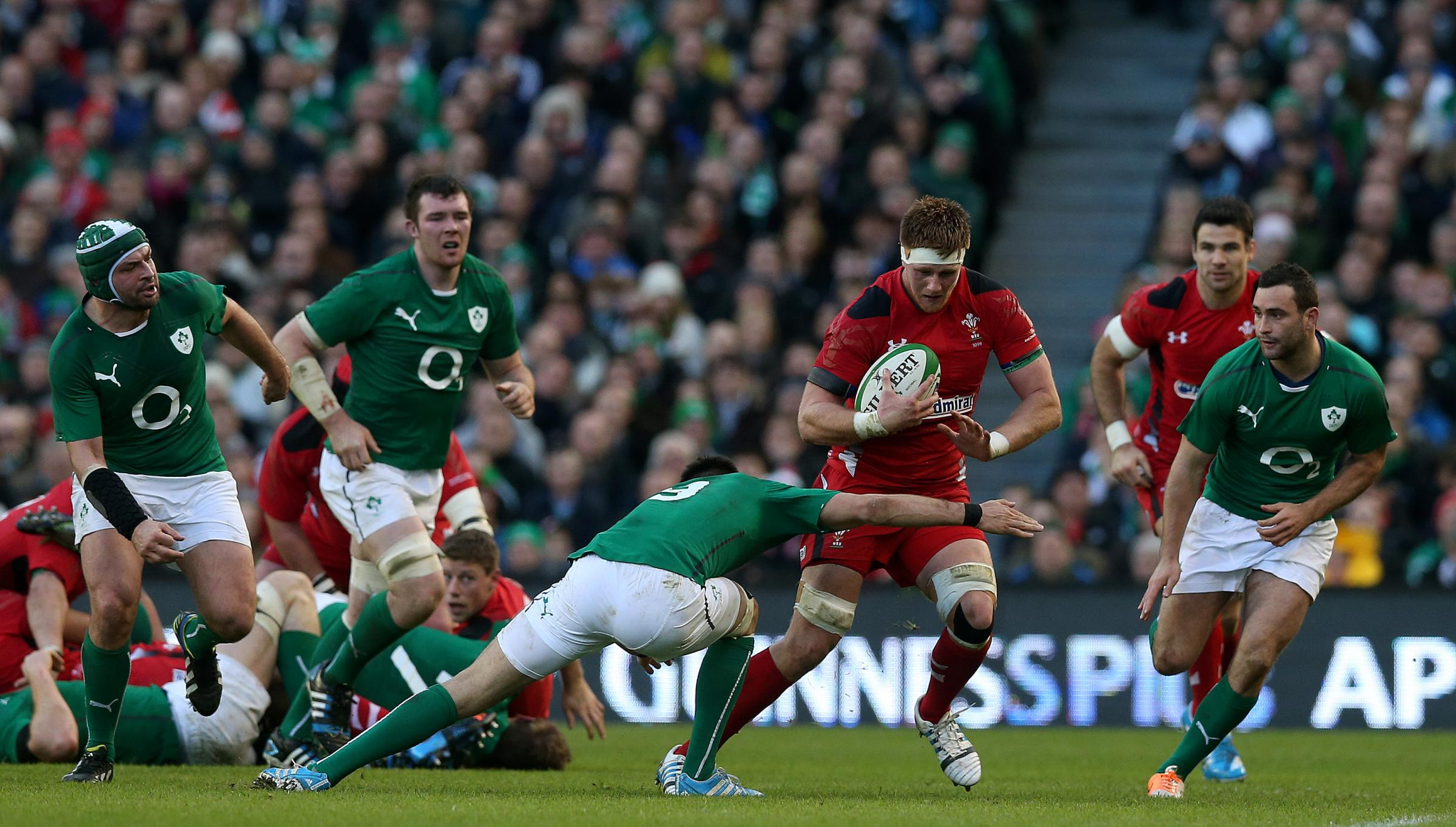 Wales's Andrew Coombs is tackled by Ireland's Conor Murray during the RBS 6 Nations match at the Aviva Stadium, Dublin, Ireland. PRESS ASSOCIATION Photo. Picture date: Saturday February 8, 2014. See PA story RUGBYU Ireland. Photo credit should rea