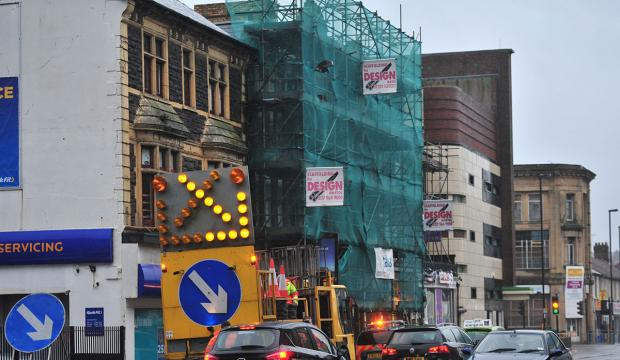 Falling bricks from Newport building cause traffic disruption