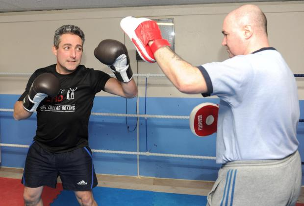 South Wales Argus: Monmouthshire author and former criminal barrister Matthew Hall trains with St Joseph's coach Roger Williams prior to his white collar boxing bout (3925444)