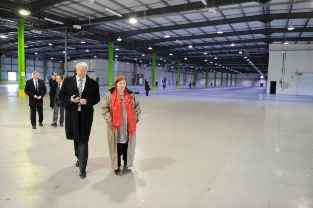 South Wales Argus: Minister Edwina Hart and Ivan Dunleavy of Pinewood Shepperton at the film studio site in Wentloog