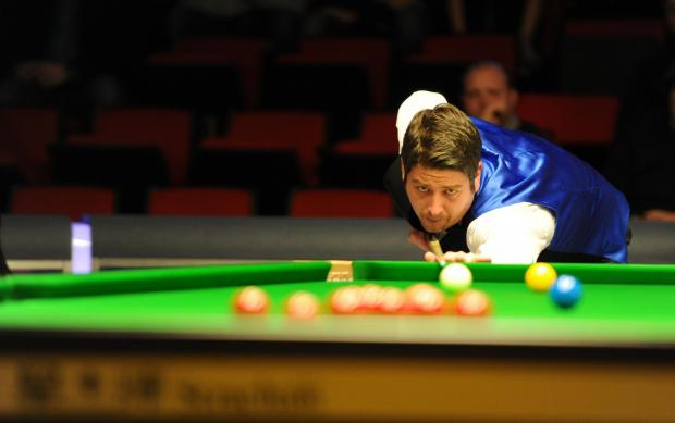 HE'S THROUGH: Welsh snooker ace Matthew Stevens in action on day one of the Welsh Open at the Newport Centre