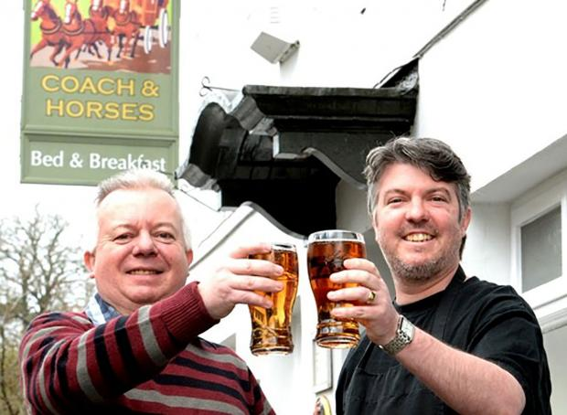 HAPPY HOUR: Landlord of the Coach and Horses in Chepstow Ian Meyrick and son Nic celebrating the good news
