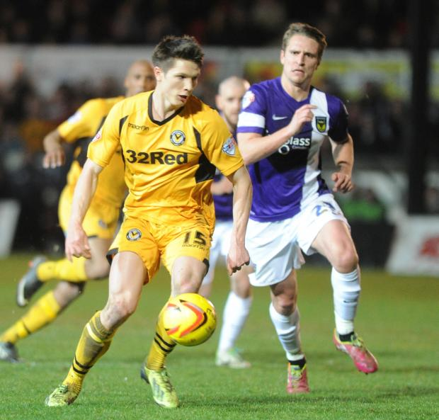 BELIEF: County midfielder Ryan Burge in action against Oxford United