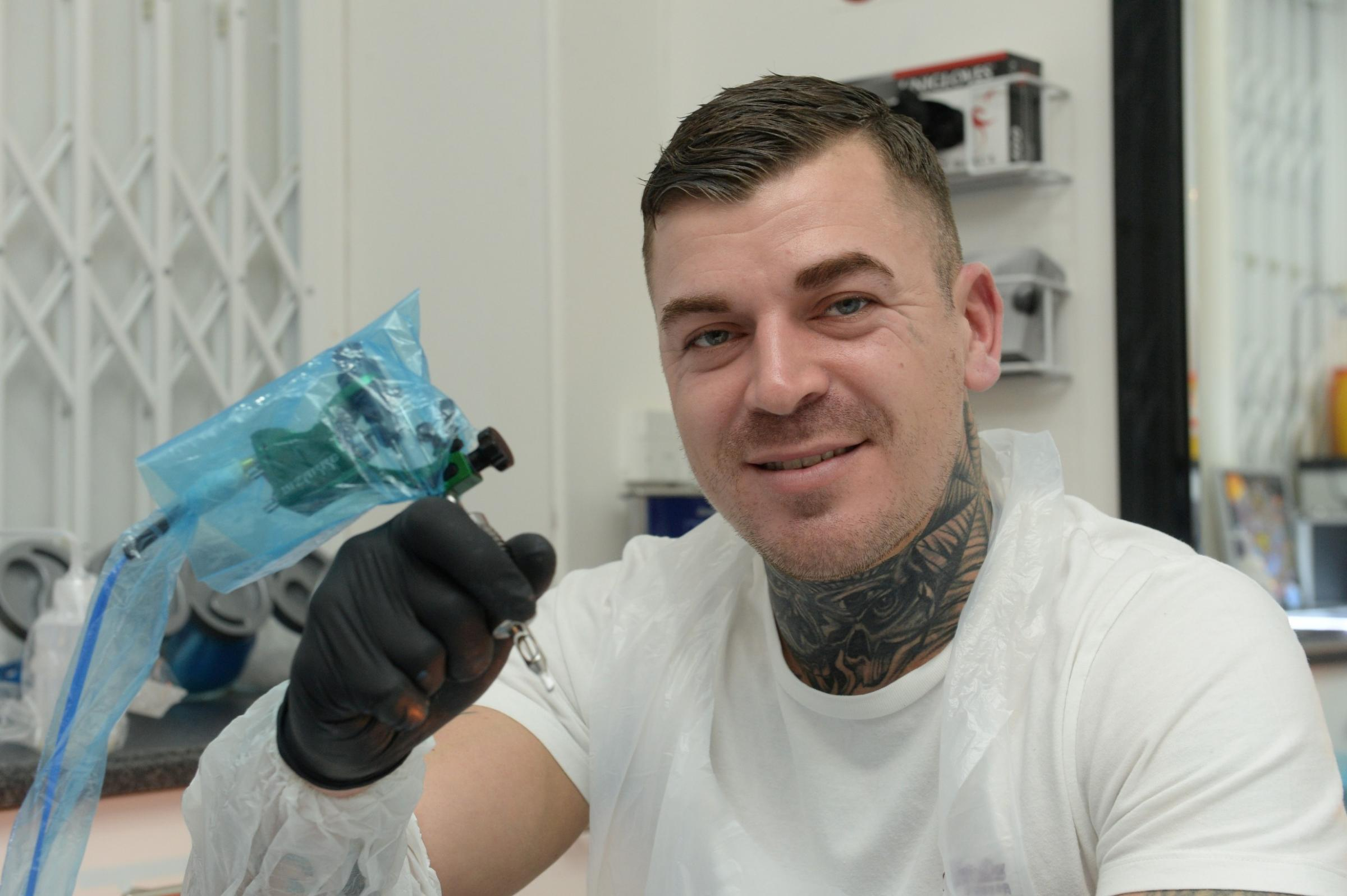 INKinc the Tattoo Lounge, in Blaenavon, Pontypool, run by tattooist Aron Walton, received the top rating from the local authority, Torfaen Council. It has become the first in the UK to receive a rating from the Tattoo Hygiene Rating Scheme. Pictured is Ar