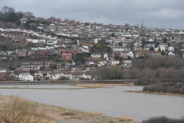 South Wales Argus: Flooding caused after the River Usk burst its banks at Caerleon
