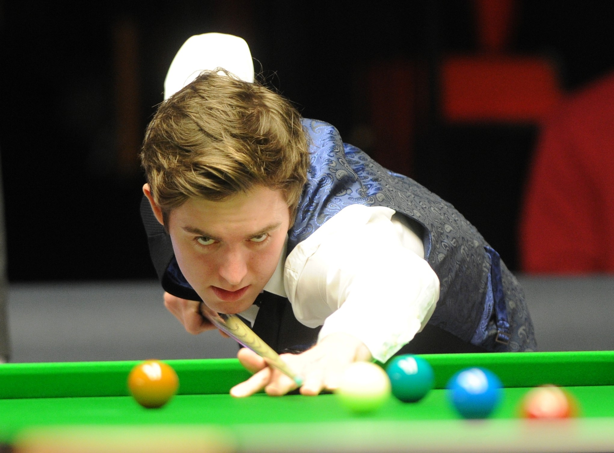 OUT: Cwmbran's Jak Jones on his way to defeat against Liang Wenbo on Saturday