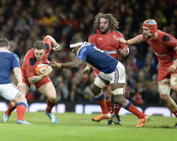 South Wales Argus: BIG WIN: Adam Jones, centre, watches on as George North goes for the gap against France