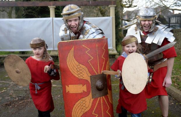 South Wales Argus: Roman Army themed week at the National Roman Legion Museum, Caerleon. Pictured are youngsters Libby Kerslake and Courtney Price with museum employees David Richards and Verdun Howells. (4251388)