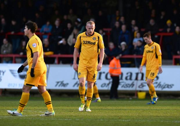 DISAPPOINTED: Newport County midfielder Lee Minshull, centre