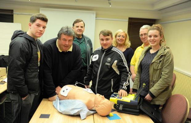 South Wales Argus: Welsh Hearts, in partnership with the Welsh Ambulance Service, arranged a training day in the Hilton at Newport, to train people on how to use portable heart defibrillators.  Pictured are members under training that included Newport County