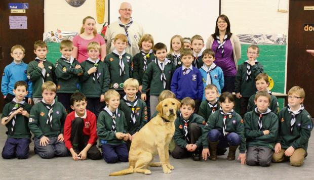 Guide dog puppy Sparkey meets the 1st Panteg Cub Scouts at New Inn