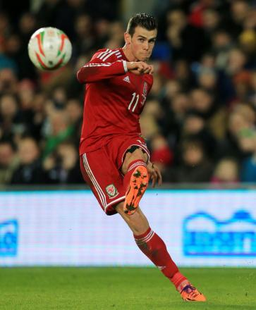 Wales' Gareth Bale takes a free kick during the International Friendly at Cardiff City Stadium, Cardiff. PRESS ASSOCIATION Photo. Picture date: Saturday November 16, 2013. See PA story SOCCER Wales. Photo credit should read: Nick Potts/PA Wire