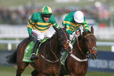 GREAT PERFORMANCE: Jezki, ridden by Barry Geraghty, on their way to winning the Stan James Champion Hurdle Challenge Trophy from My Tent Or Yours ridden by Tony McCoy (right) during Champion Day at Cheltenham Racecourse yesterday
