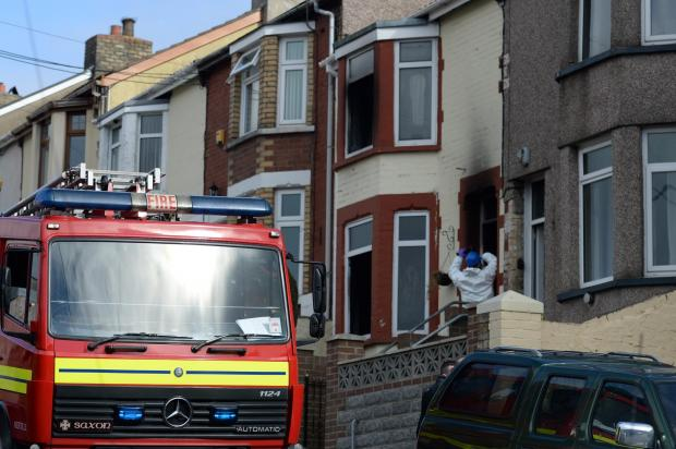 House fire on Bryngwyn Road, Six Bells, near Abertillery this morning. Fire crews and forensic officers at the scene of