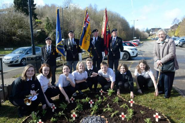 Official opening of memorial garden in Abersychan. Pupils from Abersychan school with representatives of the Blaenavon Royal British Legion and Cwmbran and District ex services association along with Nancy Felton (right) who has been selling poppies in th