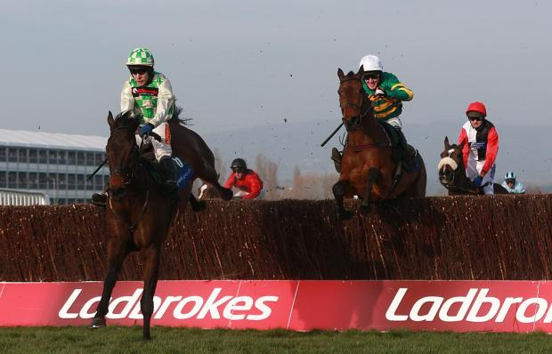 Ballynagour ridden by Tom Scudamore (left) before winning the Byrne Group Plate chase during St Patrick's Day at Cheltenham Racecourse, Cheltenham. PRESS ASSOCIATION Photo. Picture date: Thursday March 13, 2014. See PA story RACING Cheltenham. Photo c