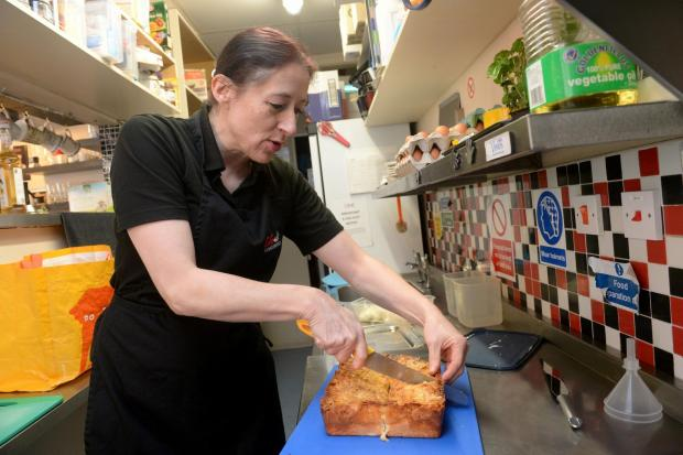 South Wales Argus: Coffee Continental in Blackwood - Esther Apoussidis. Esther cutting her special Bienenstich cake. (4424465)
