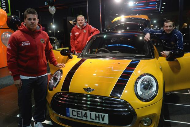 South Wales Argus: Newport County players and management at unveiling of the New Mini at the Sytner garage in Newport. County players Danny Crow and Lee Minshull along with manager Justin Edinburgh at the launch of the new Mini. (4609002)