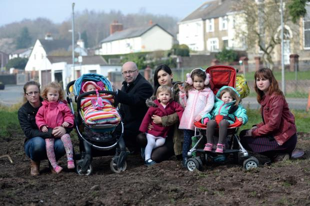 Local Playground in Rhiwederin was dug up unexpectedly over the weekend. Pictured (left to right) Nichola Owen with Lily and Sophie Owen, Councillor David Williams, Gemma Brace with Evelyn and Gwenny Brace, and Helena Watkins with Pixie Davies. (4602581)
