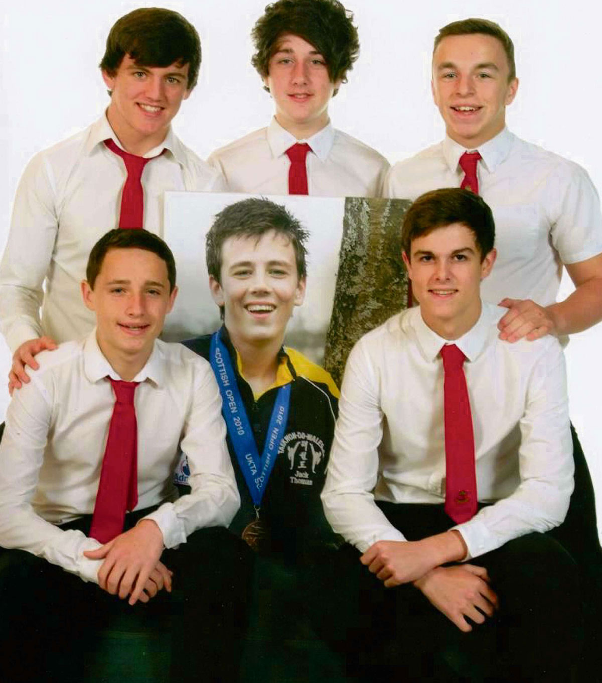 FRIENDS FOREVER: Jack's friends insisted he would be included in the end of year 11 photo shoot. Front from left to right: Jordan Collier, Jack Thomas, Kane Jones; and back: Owen Davies, Arron Brimble and Scott Winnel