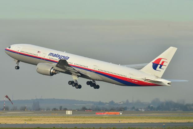 The Malaysia Airlines Boeing 777-200ER which disappeared seen earlier this year taking off from Roissy-Charles de Gaulle Airport in France