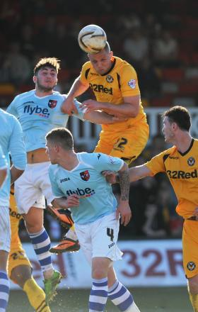 EXPERIENCE: Harry Worley heads for goal against Exeter on Sunday