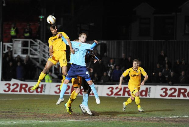 HIGH RISER: Newport County's Chris Zebroski wins an aerial duel against Dagenham and Redbridge