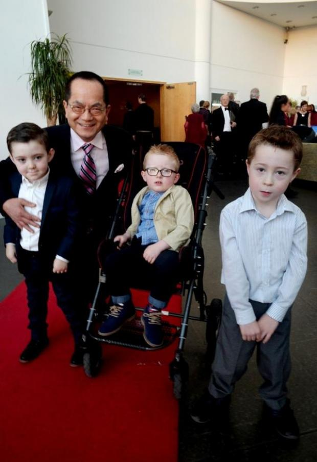 South Wales Argus: US surgeon Dr TS Park with (left to right) Bayli Lippiett, Leo Dixon and Brecon Vaughan