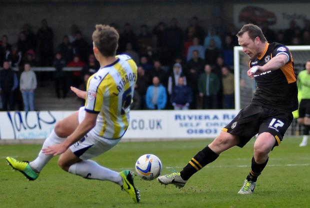 RETURN: County captain Mike Flynn has a shot at goal at Torquay on Saturday